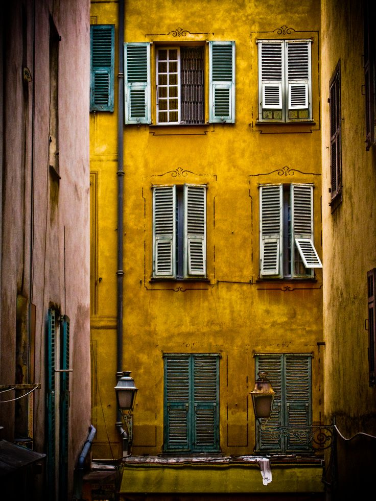 Beautiful Mustard Yellow Building With Old Wooden Shutters