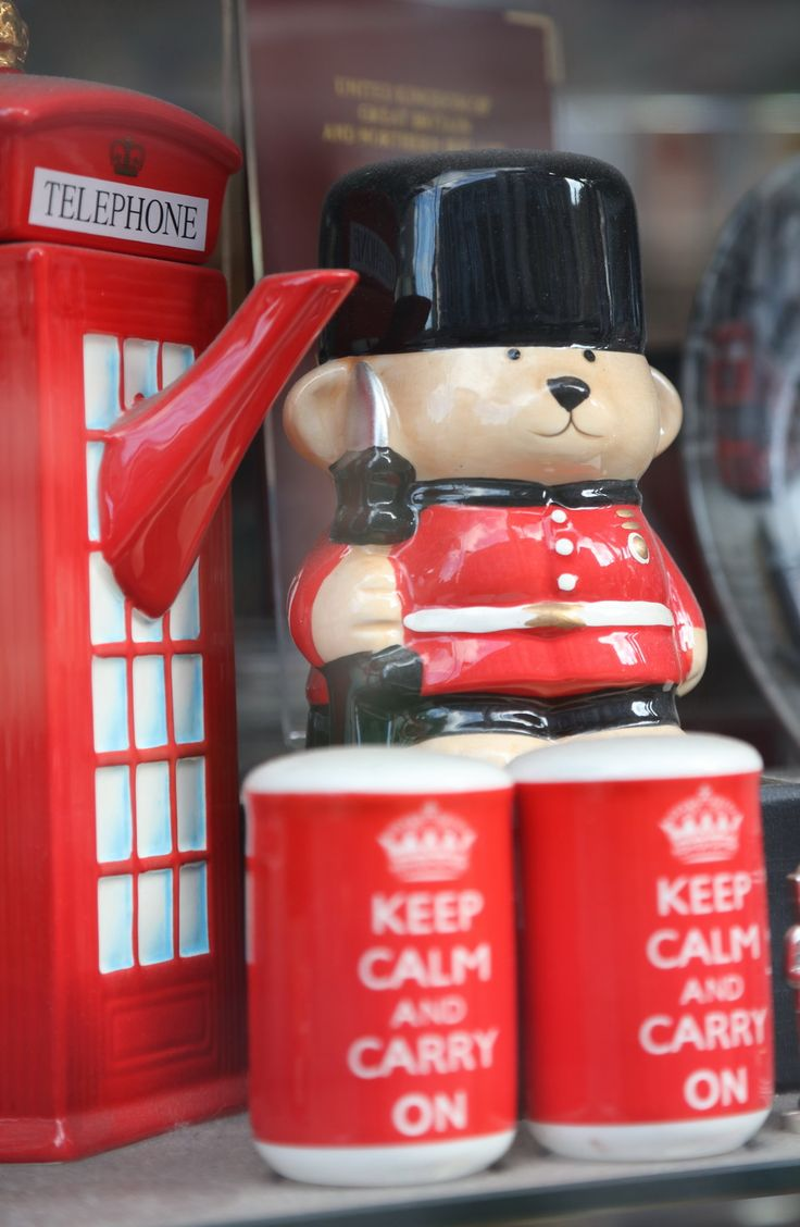 A very British-looking bear, with a very English slogan, next to a very London-like telephone booth which (because it's England, of course) is actually a tea kettle.  (Hmm.  I wonder if this is a tourist store?)