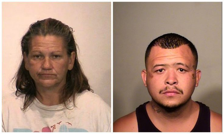 Modesto Police arrested Maria Anzaldua and Raymond Chavez for engaging in sexual acts on a grassy area in a busy intersection. (Credit: Stanislaus County Sheriff's Department)