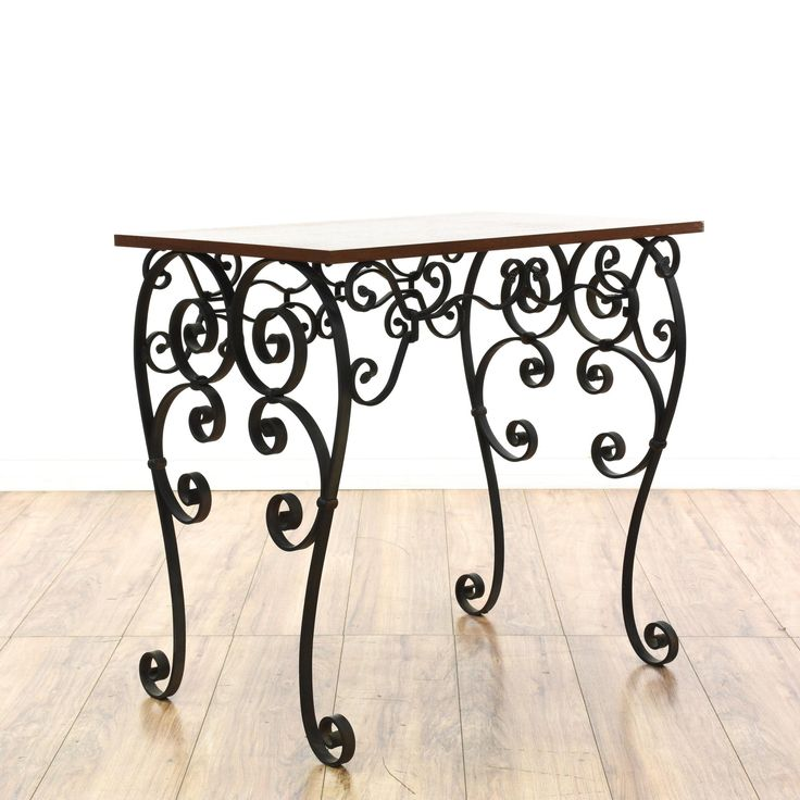 This tall side table is featured in a wrought iron with a black finish. This end table has a cherry wood table top with curved legs and intricate scrollwork. Perfect as a small console table in an entryway!  #americantraditional #tables #endtable #sandiegovintage #vintagefurniture