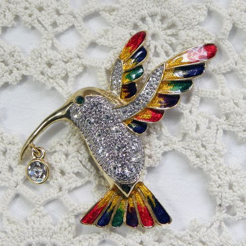 Enamel humming bird brooch large circa 1980s Sparkling jewellery covered with brilliant clear diamante onto a silver textured body Red green navy enameling