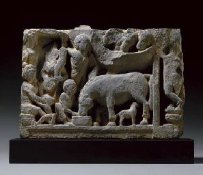 A Gray schist relief of Siddharta's groom Chandaka and his horse Kanthaka Gandhara, 2nd/3rd century  Chandaka depicted as a child with his mother on left, Kanthaka as the baby horse suckling his mother in center, with Chandaka's parents and additional figures and horses 9¾ x 13¾ in. (24.7 x 35 cm.) high