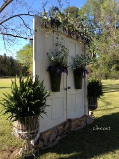 Perfectly lovely backdrop of old doors for an outdoor wedding!