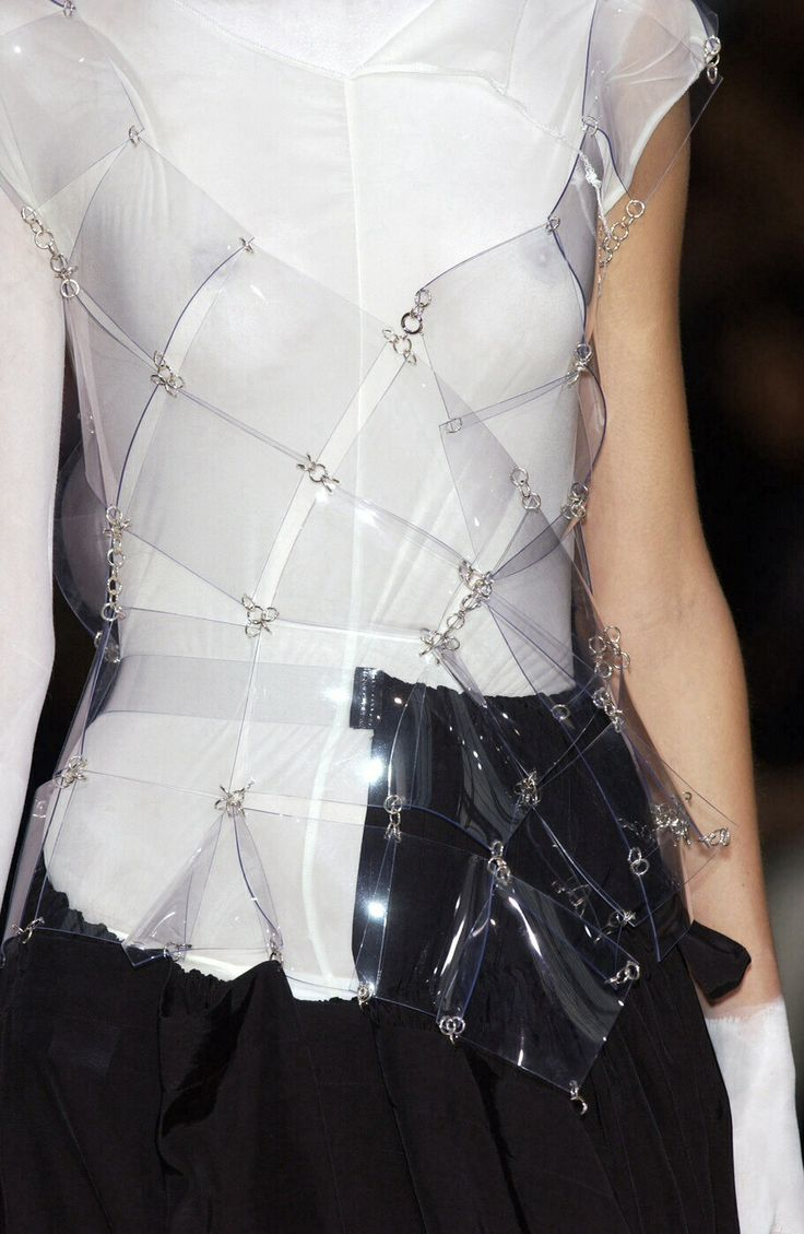 Transparency - white asymmetric top with clear plastic squares linked together with metal rings; layered fashion details // Yohji Yamamoto