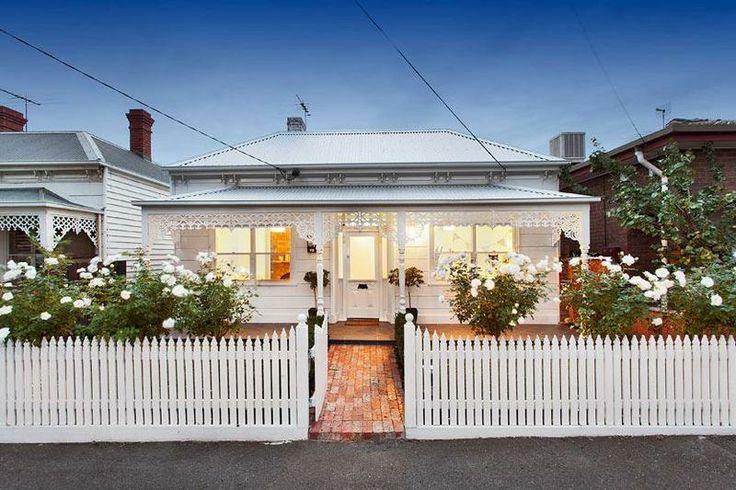 White on white Victorian house