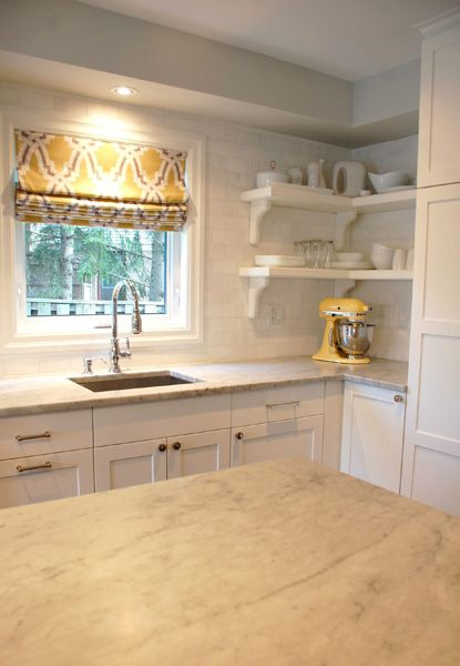 Yellow and gray kitchen featuring gray walls and window above sink covered in yellow and gray fabric, Duralee Bokara Yellow Fabric.