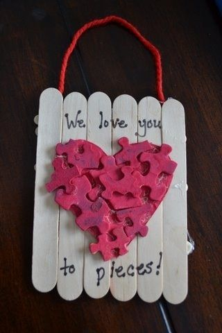 Valentine's Day craft for kids. Made with puzzle pieces and craft sticks. #valentine's day crafts