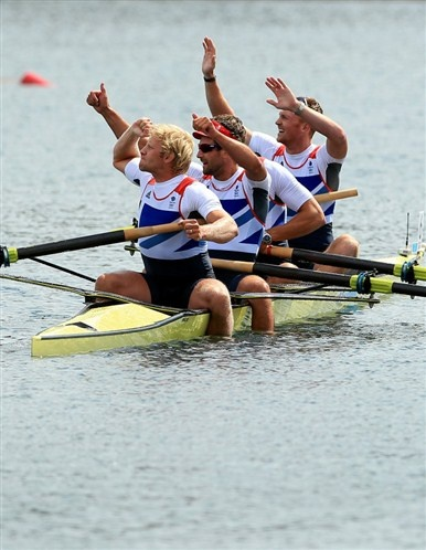 Great Britain's Men's Four of left to right Andrew Triggs Hodge, Tom James, Pete Reed and Alex Gregory celebrate winning gold in the final at Eton Dorney Rowing Lake, Windsor.