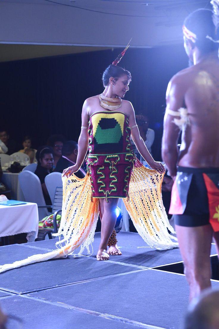 Wonderful. Papua New Guinea 'bilum' dress inspired by the Raggiana Bird of Paradise.