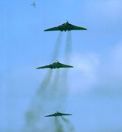 """Avro Vulcan B2s flying past at RAF Waddington in June 1978. #1 is XM605 of No 101 Squadron, #2 is XL427 of No IX Squadron and #3, desperately trying to get into position, is XM654 of No 50 Squadron. Meanwhile, display aircraft XM573 of No 44..."
