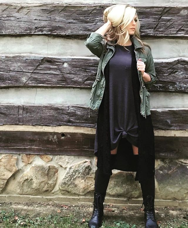 I love this edgy Lularoe look, Kim has added knee high motoboots, Army cargo jacket, & tied her solid Carly in the front for more of a fitted look. What other accessories do you love pairing with the Lularoe Carly? #lularoe  Shop for similar looks @lularoetaratrainor