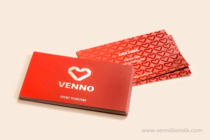 Silver foil stamping on our silk business cards with a bright red gradient background and spot uv pattern of the logo on the back. Printed by http://vermillionsilk.com