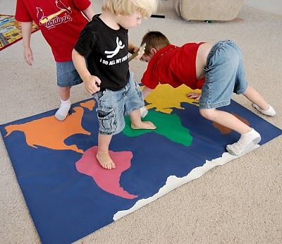 global twister! Too cute! Older students can use this in a variety of ways to reinforce academic geometry themes including flags, animals, plants, and places of the world...to name a few.