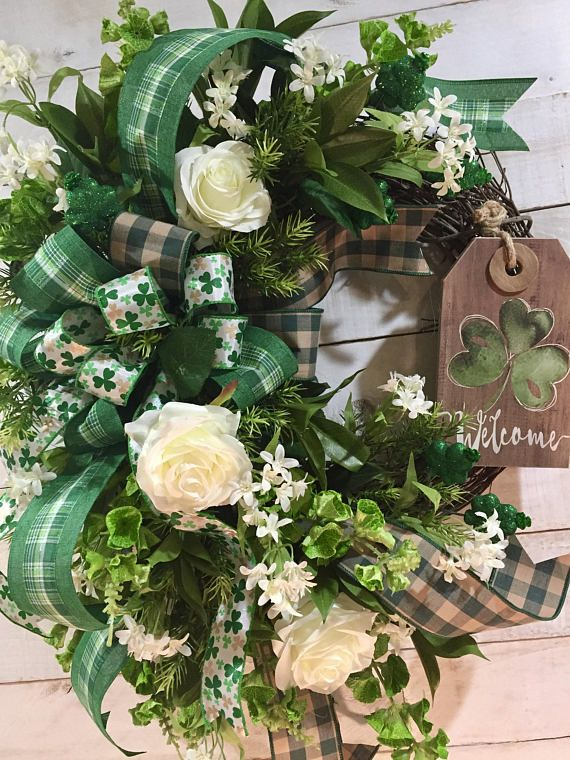 This large sized, beautifully designed St. Patricks Day Wreath features a multitude of lovely green, cream and white silk florals, including vibrant Bells of Ireland stems, laurel bush sprays and asparagus fern, all securely attached to a round grapevine base. Green and beige checked