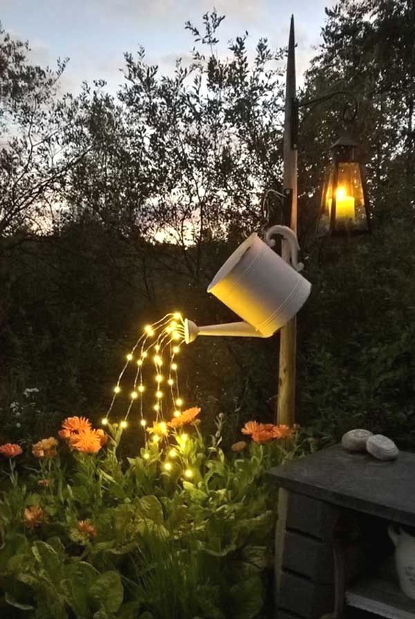 Howla Phurthmuth Saved To Diyyour Garden Flowers Can Enjoy Lighting Drops From This Repurposed Watering Can Pat Garden Projects Garden Art Garden Inspiration