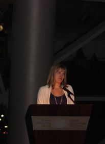 Tamarack Homes' Michelle Taggart congratulates the organizers of the  2013 Tamarack Ottawa Race Weekend at the President's Reception.