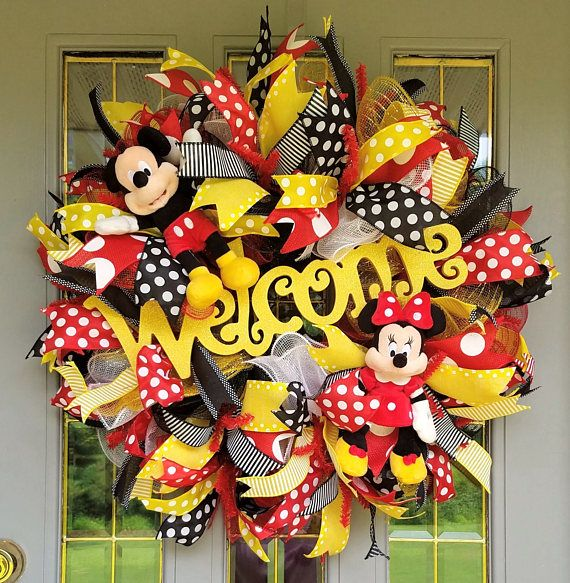 Calling all Disney fans (and I am one too!). A Welcome Wreath with Mickey and Minnie will be perfect for your front door! The wreath is created using four colors of deco mesh, red, black, yellow, and white, using a ruffle technique. The Welcome sign is made of MDF with glitter. The focal points are plush Mickey Mouse and Minnie Mouse. It is adorned with a variety of ribbons in red, black and yellow. This wreath has a lot of ribbon! This wreath is made on a 24 inch work wreath but measures…