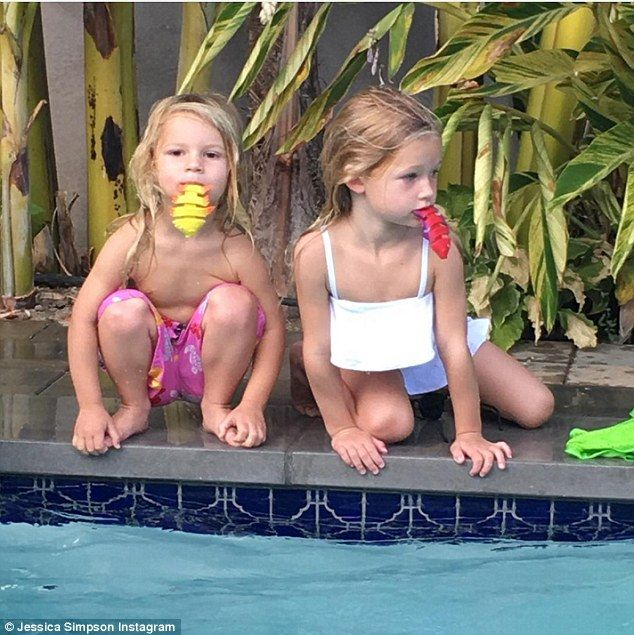They could be twins! Jessica Simpson's kids enjoy poolside fun