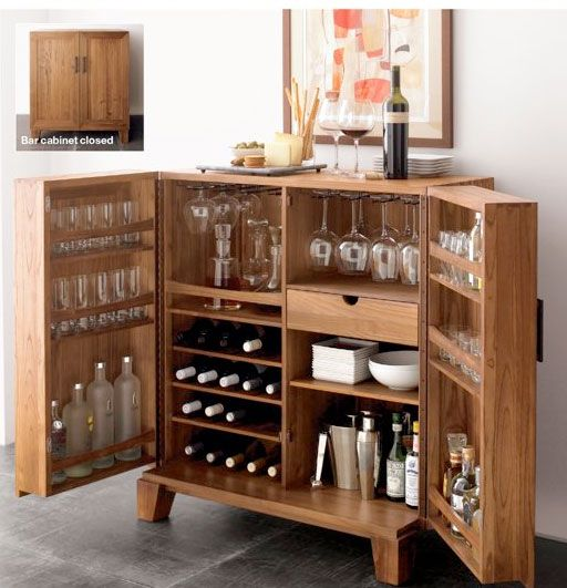 Open this custom bar cabinet and get the party started. Everything you need in one place with wine glasses, mixers, spirits and plates.