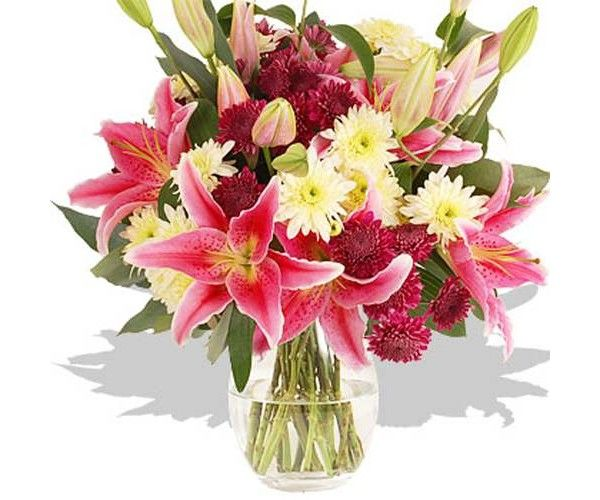 This arrangement contains the following flowers: 5x Purple Chrysanthemum 4 x White Chrysanthemum 5 x Pink Oriental Lilies Eucalyptus Robusta Hand-tied by our florists -Please note the vase is not included.
