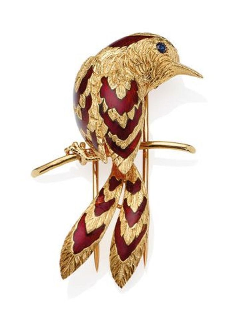 Brooch, by Cartier Paris~ Modeled as a bird perched and facing right, the textured body and wings with fine feather detail, enhanced by red enamel accents, to a circular-shaped sapphire eye, signed Cartier Paris, numbered 013337, maker's mark, French assay mark for gold, l