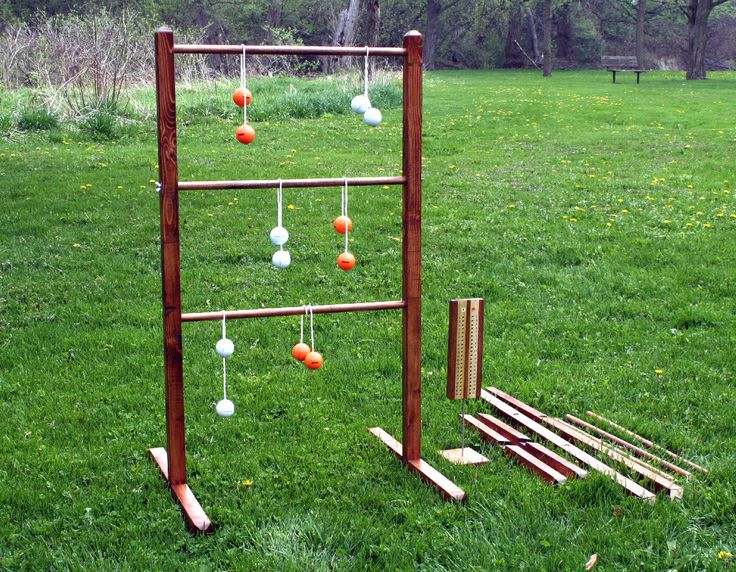 Wooden Ladder Ball Game Set, Stained, with Easy Assembly / Dis-assembly Ladders, Stands, and Real Golf Ball Bolas by RozEmazingDesigns on Etsy https://www.etsy.com/listing/159123444/wooden-ladder-ball-game-set-stained-with