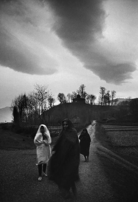Magnum Photos-Ara Guler IRAN. A cold windy day as three women return from a holy site on a hilltop not far from Tehran. 1969