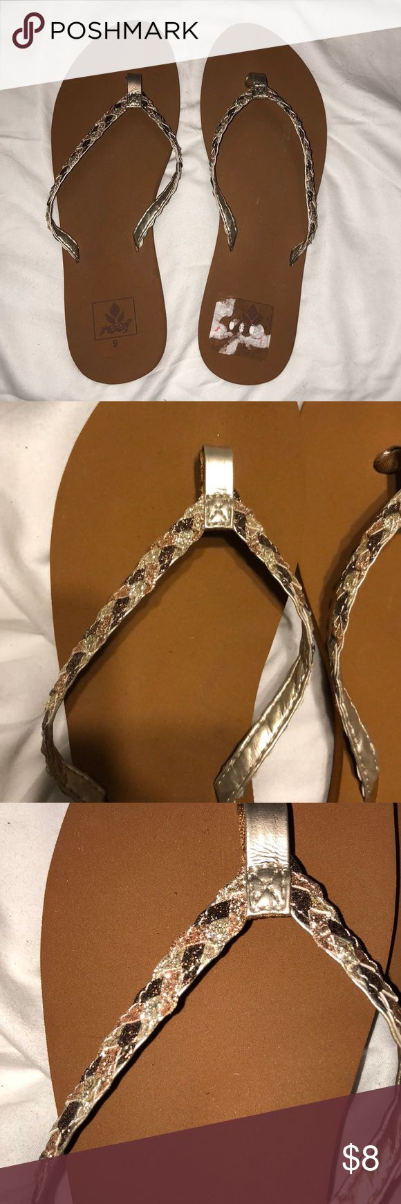 Flip flops Size 9 brown Reef flip flop with sparkly braided band!  Super cute, especially for summer time! Worn once but they were a little too big :-( Also, small problem getting the sticker to come off cleanly on the right flop. Still in great condition! Reef Shoes Sandals
