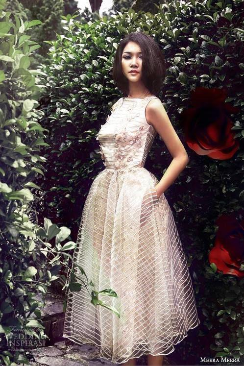 https://www.cityblis.com/1397/item/12570  Mini Wedding Dress - $800 by Meera Meera Fashion Concept  Sleeveless tea-length pastel pink wedding dress with blush voile overlay.