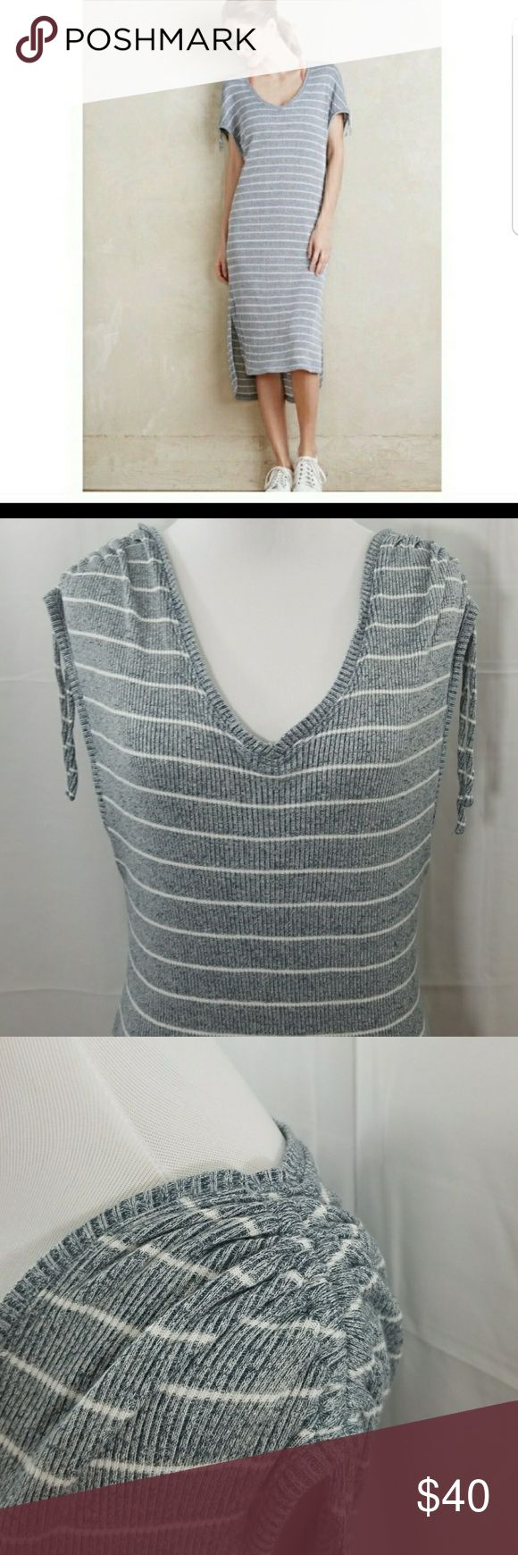 """Anthro - Saturday Sunday Gray striped dress This is an Anthropology Saturday Sunday dress .The Dress is Gray and white striped with a very comfortable Jersey material. It features a  vneck with adjustable straps at the shoulders and a button tie back on the back of the dress It also has a high low hemline. E22 Pit to pit 16"""" Length 43"""" Anthropology Dresses Midi"""