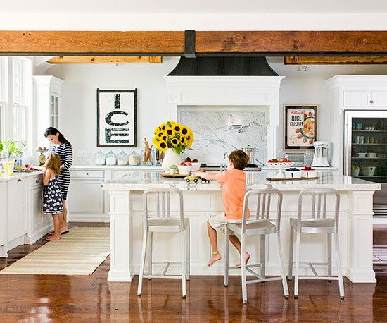 Kid-Friendly White Kitchen Makeover In a house where there are swings in bedrooms and a firefighter's pole leading downstairs, a family manages to blend style and function into their kitchen while adding a few youthful touches along the way.