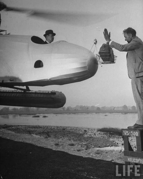 Igor Sikorsky demonstrates a helicopter's ability to hover. 1942 Photographer: Dmitri Kessel