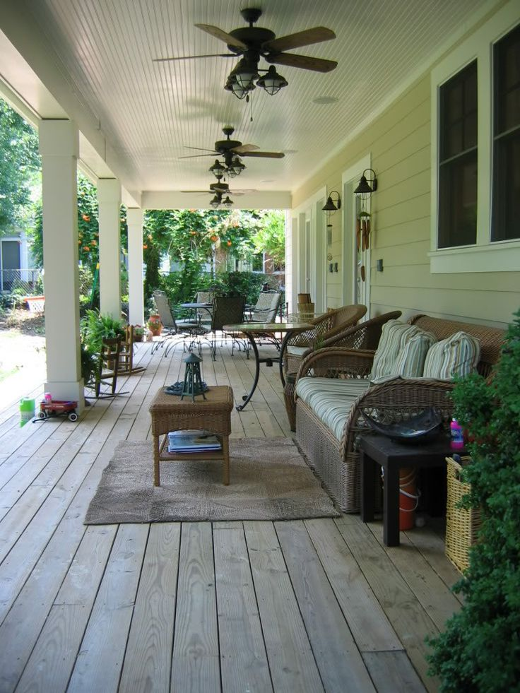 this back porch is southwestern because of the colors and woven furniture