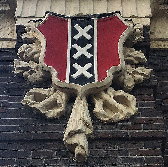 The XXX symbol is three St. Andrew's Crosses in white on a black stripe on a red background. On the flag they appear horizontally. St. Andrew was a fisherman who lived in the 1st Century AD and was said to have been crucified on an X-shaped cross. The Amsterdam XXX symbol dates back to the year 1505 when the city was a fisherman's town, so the coat of arms was established as the symbol for the city itself and it also flew as a flag on all ships registered in Amsterdam. Some people say the…