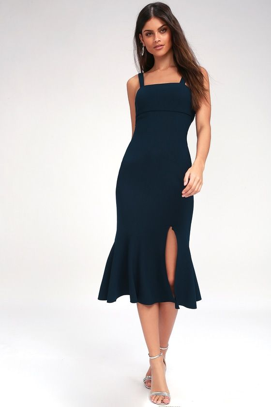The Finders Keepers Tribute Navy Blue Midi Dress can be dressed up or down for the perfect look! Tank straps and darted bodice with tying back detail, top this chic sheath made from medium-weight stretch knit. Figure-skimming midi skirt with ruffled hem and front slit.