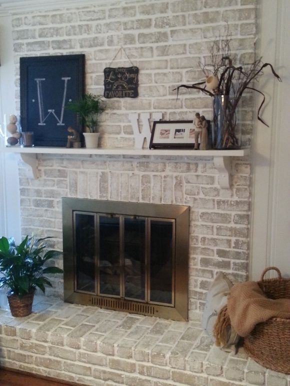 $20 Fireplace Makeover: How to get a whitewashed look on a fireplace already painted white or hide that ugly orange brick from the 70s for cheap!