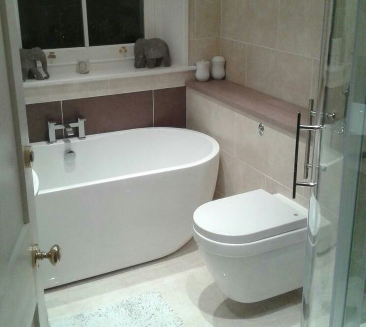 Perfect tiny bathroom design for trying to fit freestanding bath and separate shower into a Bathroom design winchester uk