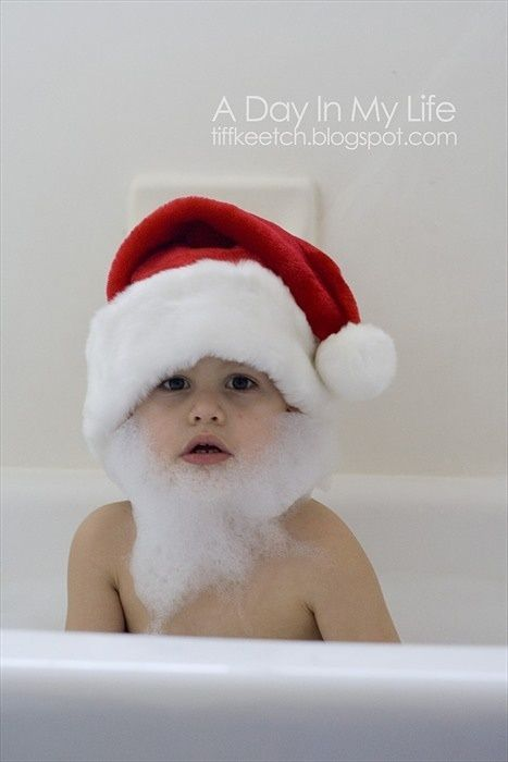 Baby in the bath being Santa Claus.