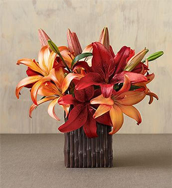 I think I'm liking the lily and cala lilys most!! I like these colors and want red but not roses.
