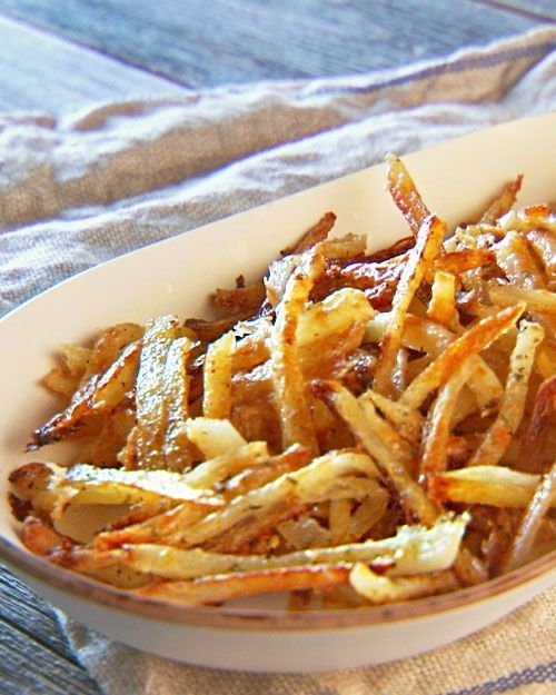 The secret to awesome oven fries is presoaking them in salted water, which makes the potatoes release a bunch of their moisture before cooking. This ensures they will crisp up without having to risk burning them..