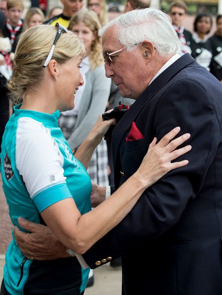 Christopher Rhys Jones hugs Sophie, Countess of Wessex after she finished her bike ride from Edinburgh to London at Buckingham Palace on September 25, 2016 in London, United Kingdom.