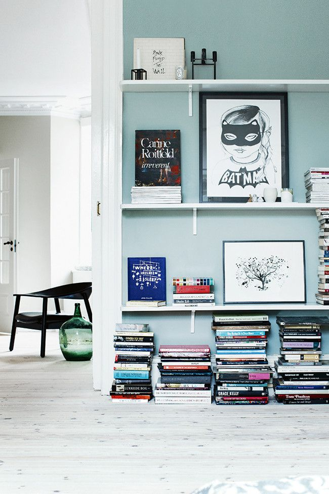 colorful wall and display shelving in a Danish home