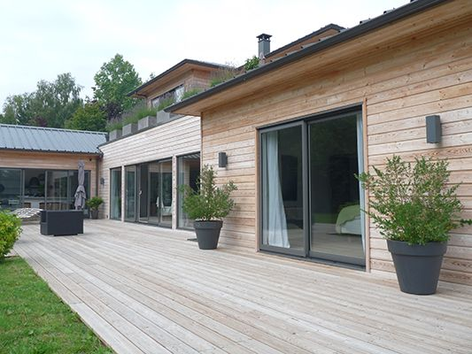 Wood patio and wood walls on home