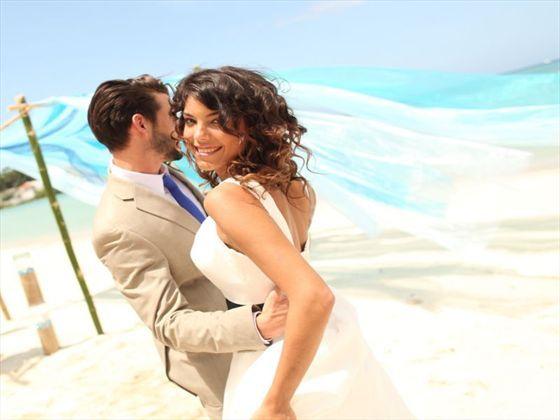 Newlyweds on the beach at Breezes Bella Costa, Cuba