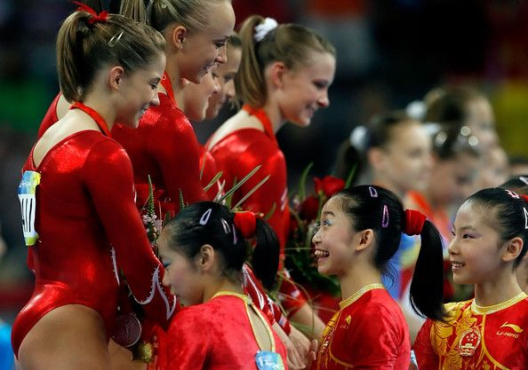 Shawn Johnson of the United States is congratulated by He Kexin of China after the team final event at the National Indoor Stadium during Day 5 of the Beijing 2008 Olympic Games on August 13, 2008 in Beijing, China.