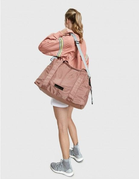 5abe94010181 Duffel bag from Adidas by Stella McCartney in Burnt Rose. Two top handles.  Removable adjustable shoulder strap. Dual exterior side pockets. Top zip  closure.