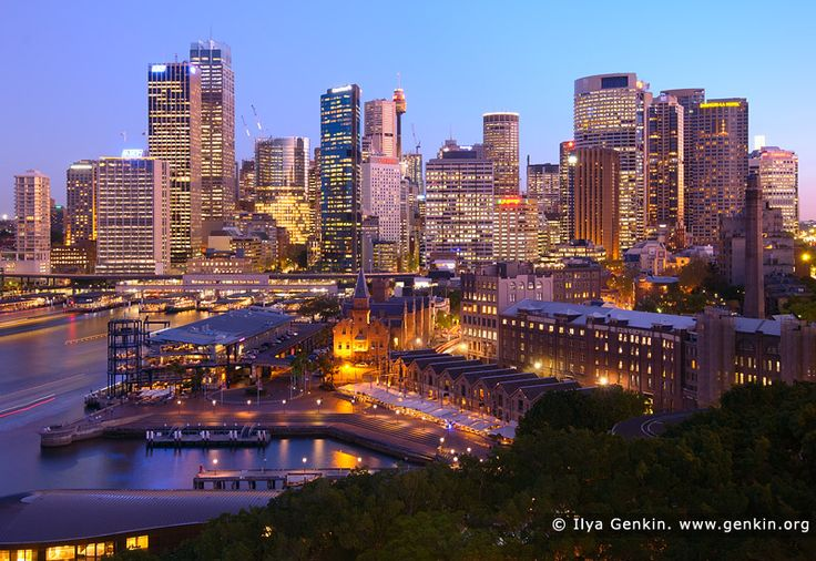 Circular Quay and Sydney City at Night, Sydney, New South Wales (NSW), Australia. As dusk turns into night, Sydney skyline is illuminated with the lights of the high rise buildings in CBD, Circular Quay and the Rocks.