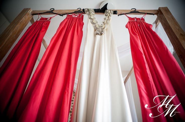Laekin's stunning signature @Johanna Johnson gown hanging with her bridesmaids' dresses.   Laekin & Chris