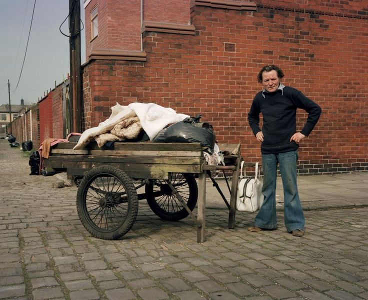 A man with his loaded cart, Salford, Greater Manchester, England, United Kingdom, 1986, photograph by Martin Parr.