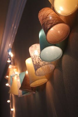 Cover plastic cups in fabric and string them on white lights! Cute, easy, cheap DIY!   could be good for patio or outside by the pool lighting for party